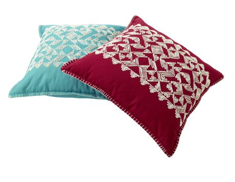 Teal and Pink Toss Pillows with White Embroidery