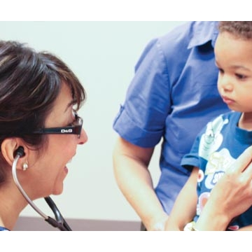 Hengameh Raissy, PharmD, listens to a young patient's lungs