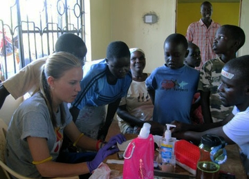 UNM nursing student at work in Kenya clinic