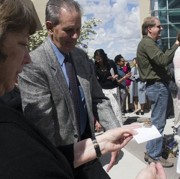 Families release butterflies at service