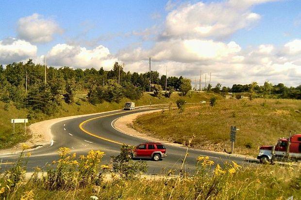 cars turning rural road