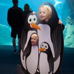 Kids pose with penguin cutout