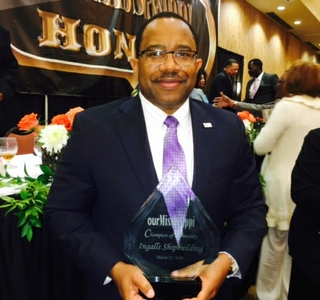 Edmond Hughes Accepts Diversity and Inclusion Award