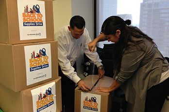 City National colleagues prepare donations for the bank's 6th Annual School Supplies Drive
