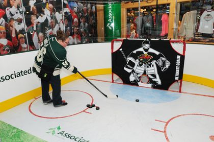 Fans are invited to enjoy Associated Bank's Power Play Zone fan challenge at Xcel Energy Center at all Wild home games.