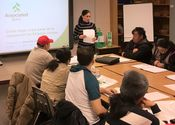 Joannette Cintrón, residential loan officer at Associated Bank, speaks to a group of parents during a financial seminar at Richard R. Green, Central Park School in Minneapolis
