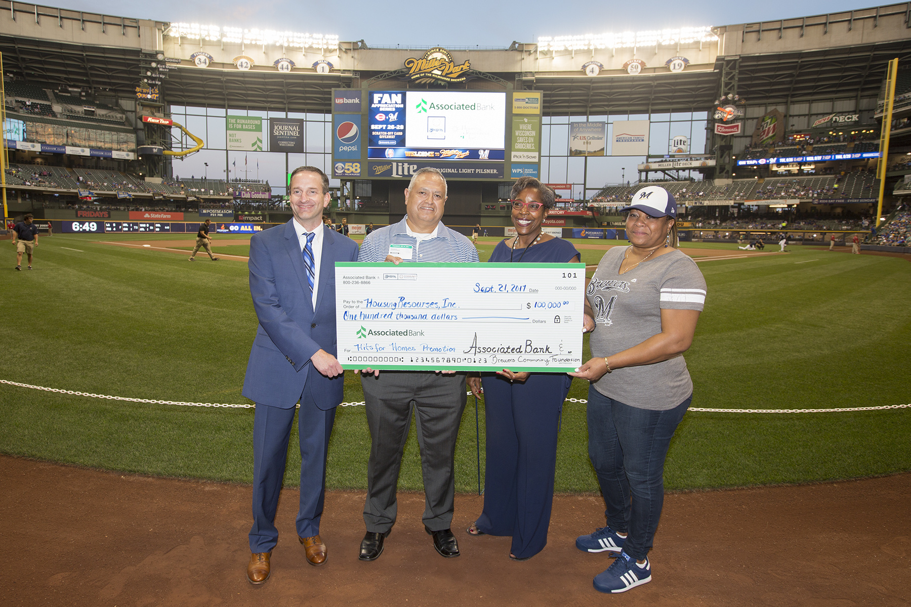 Hits For Homes Program At Miller Park Results In 100 000 Donation For Home Repair Assistance In The Milwaukee Area Associated Bank