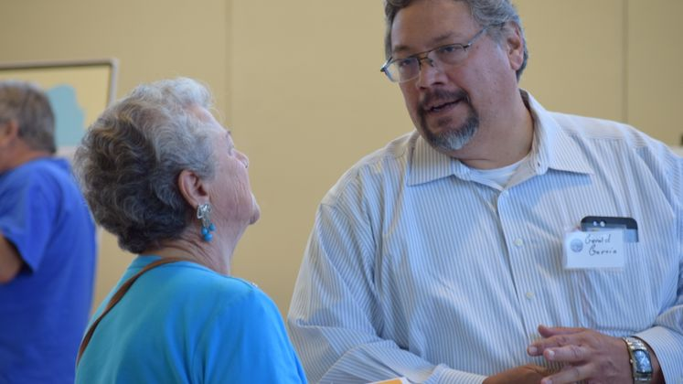 G. Garcia talks to a resident about Wastewater Management Plan
