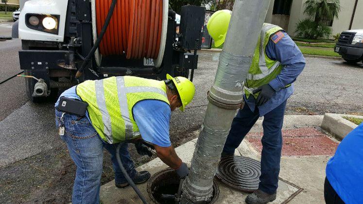 Utilities Crews Cleaning Storm Drains