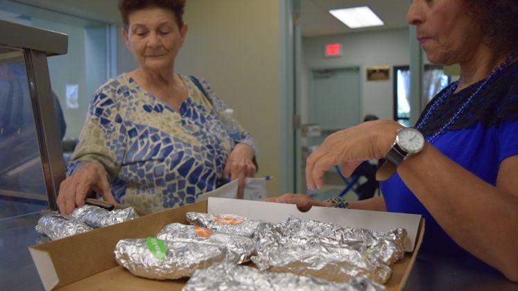 Patrons Celebrating National Taco Day at Broadmoor Senior Center