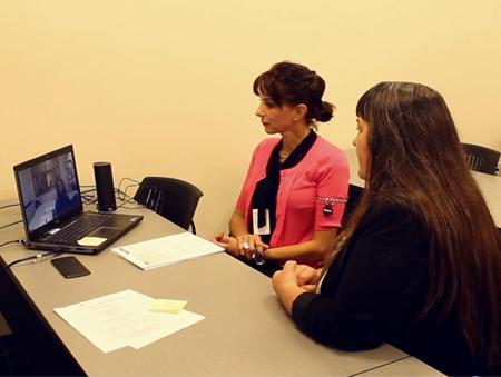 SHARP videoconference with interpreter - self-help center