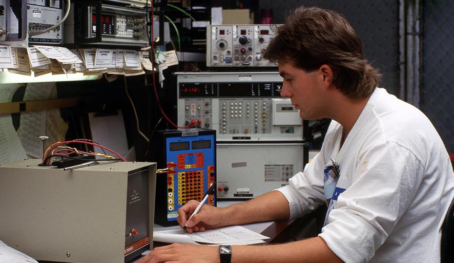 Young man at controls c1980  0516