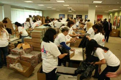 Dunkin' Brands Employees Join Together to Stuff 3,000 Back Packs for The Greater Boston Food Bank