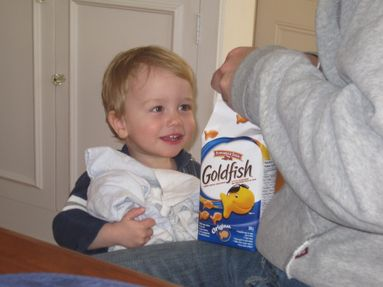 Brayden, one of our littlest Goldfish fans, happily enjoys a snack!
