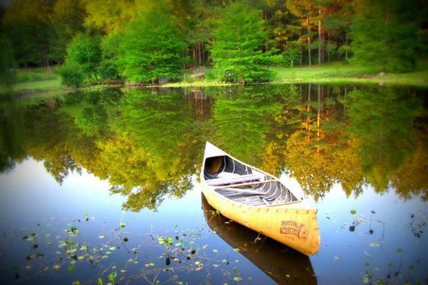 fall empty canoe waiting on lake