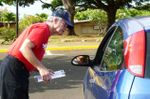 CarFit checker with clipboard and man in car