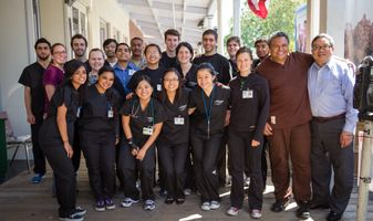 VSP provider Thomas Wing, OD with VSP volunteers and UC Davis medical students