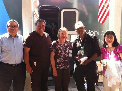 VSP optometrists Thomas Wing, OD, and Helen Kwong, OD, with a California veteran and VSP representatives