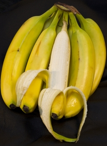 Bananas - bunch with one peeled with heart shape