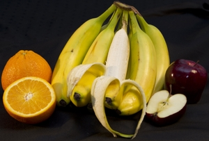 Fruits - Whole Orange with half, Bananas one peeled, Whole Apple with half