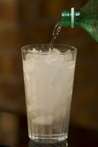 Soft Drink -Clear -pouring with bottle