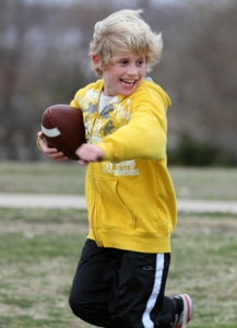 Boy running with football 4