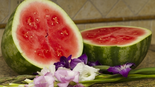 Watermelon Sliced with flowers close up