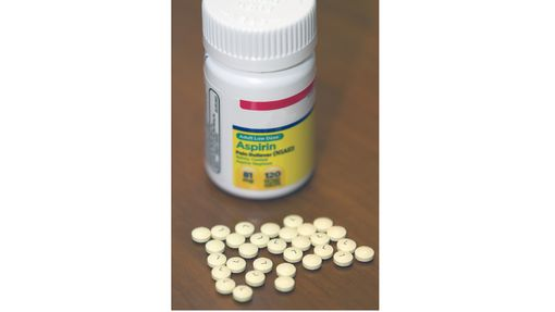Low Dose Aspirin Bottle and tablets