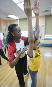 Nasha Thomas-Schmitt with AileyDance Kids at Public School IS 528